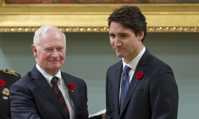 Prime Minister Justin Trudeau shakes hands with Governor General David Johnston after being sworn in as prime minister of Canada at Rideau Hall in Ottawa on Nov. 4, 2015. (Justin Tang/The Canadian Press via AP)