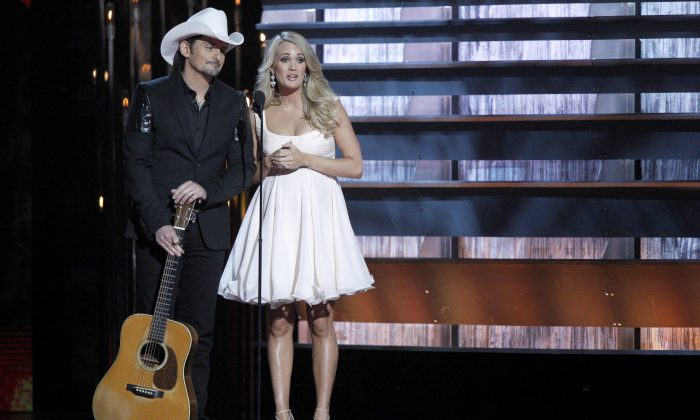 Hosts Brad Paisley (L) and Carrie Underwood appear at the 48th annual CMA Awards in Nashville, Tenn., on Nov. 5, 2014. The pair return to host another CMA Awards event, Wednesday, Nov. 4, 2015, which includes three days of rehearsals. (Wade Payne/Invision via AP)