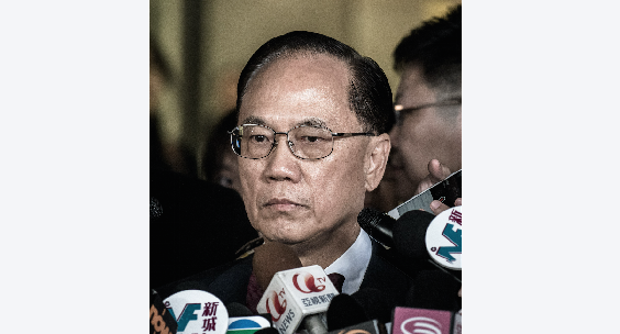 Hong Kong's former Chief Executive Donald Tsang addresses the media outside the Eastern Court in Hong Kong on Oct 5.  (Philippe Lopez/Getty Images)