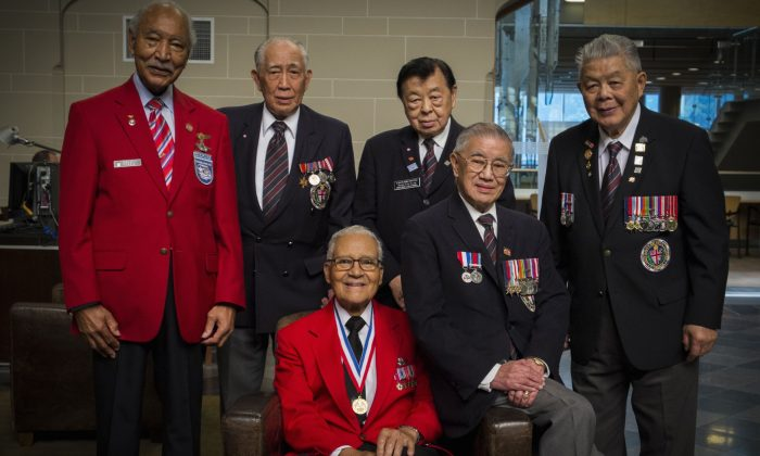 (L-R) Second World War veterans Bob Ashby, Neil Chan, Charles McGee, Leonard Wong, Frank Wong (now deceased), and George Chow, pictured on June 28, 2013, during a visit to Vancouver by some of the surviving members of the Tuskegee Airmen, a group of African-American military pilots who fought in WWII and who also faced discrimination. (Vincent L. Chan)