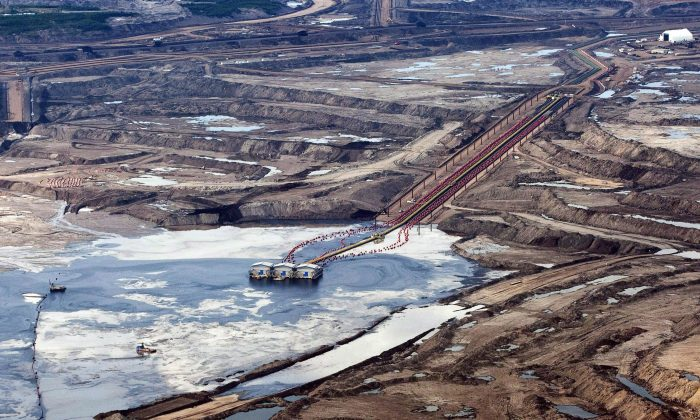 An oilsands facility seen near Fort McMurray. Fewer wells are expected to be drilled in Canada in 2016 as compared with 2015. (The Canadian Press/Jeff McIntosh)