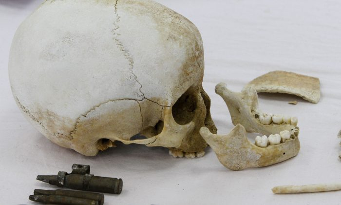 In this Feb. 10, 2010 file photo, a skull and bullets are shown at the Anthropological Laboratory, inside the United Nations controlled buffer zone in the divided capital of Nicosia, Cyprus.