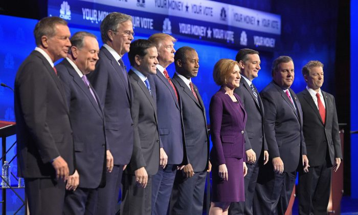 In this photo taken Oct. 28, 2015, Republican presidential candidates, from left, John Kasich, Mike Huckabee, Jeb Bush, Marco Rubio, Donald Trump, Ben Carson, Carly Fiorina, Ted Cruz, Chris Christie, and Rand Paul take the stage during the CNBC Republican presidential debate at the University of Colorado, in Boulder, Colo. (AP Photo/Mark J. Terrill)