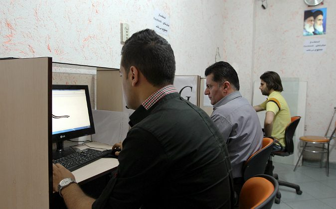 Iranians use internet at a cybercafe in the center of the Iranian capital Tehran on May 14, 2013.  (ATTA KENARE/AFP/Getty Images)