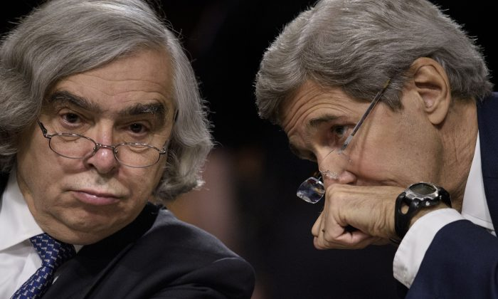 U.S. Secretary of State John Kerry (R) and U.S. Secretary of Energy Ernest Moniz at a hearing of the Senate Foreign Relations Committee on Capitol Hill in Washington, D.C., on July 23, 2015. (Brendan Smialowski/AFP/Getty Images)