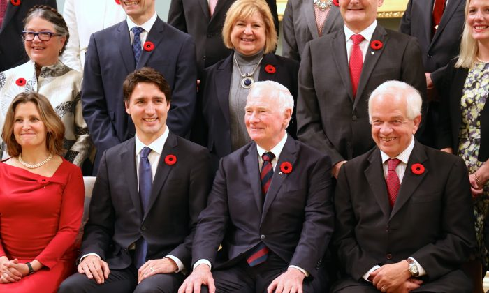 Minister of International Trade Christina Freeland, Prime Minister Justin Trudeau, and Gov. Gen. David Johnston at the swearing in of Trudeau's new cabinet on Nov. 4, 2015. (Epoch Times)