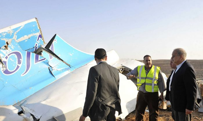 A handout picture released by Egypt's Prime Minister's office on October 31, 2015, shows PM Sherif Ismail (R) at the site of the wreckage of a crashed A321 Russian airliner in Wadi al-Zolomat in Hassana province, a mountainous area of Egypt's Sinai Peninsula. (Seliman Al-Oteifi/AFP/Getty Images)