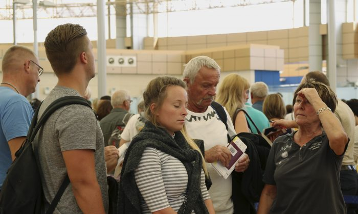 Tourists wait in the departure hall to be evacuated from Sharm el-Sheikh airport, south Sinai, Egypt, Friday, Nov. 6, 2015. (AP Photo/ Vinciane Jacquet)