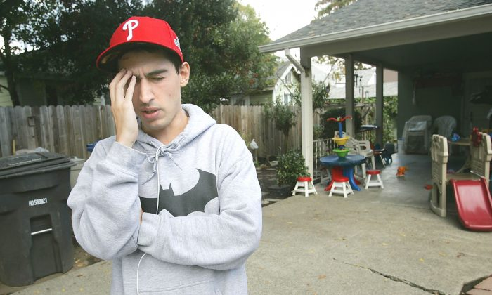 In a Nov. 2, 2015 photo, college student Luis Ortiz pauses while describing the night he ended up in the Queen of the Valley Medical Center earlier this year. Ortiz says he went to the emergency room in early September with a terrible headache and nausea, became comatose and when he woke up doctors told him he had a tapeworm larvae living in his brain and required immediate surgery. The surgery and the aftermath have greatly impacted his life, said Ortiz. (J.L. Sousa/Napa Valley Register via AP)