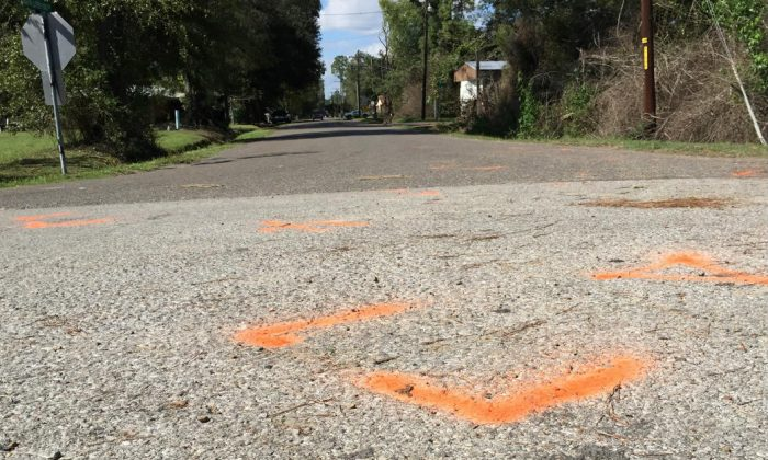 Orange paint marks the spot where a 6-year-old boy was shot and killed Tuesday night by Ward 2 city marshals in Marksville, La., on Nov. 4, 2015. The marshals had been chasing a vehicle driven by the boy's father, Chris Few. (Melissa Gregory/The Daily Town Talk via AP)