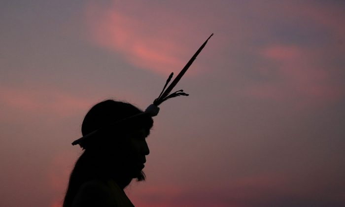 A Brazilian Xavante indigenous man attends the World Indigenous Games in Palmas, Brazil, on Oct. 22, 2015. Of the estimated 2,000 indigenous languages thought to have been spoken in pre-Columbian times in what is now Brazil, only around 160 survive today. Experts warn that as many of 40% of those remaining could be lost in the next few decades, as elders die off and young people get more access to television, the Internet and cell phones. (AP Photo/Eraldo Peres)