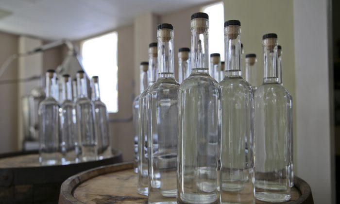 Bottles of white whiskey await their labels at the Franklin County Distilleries in Boones Mill, Va., on Oct. 22, 2015, the first legal distillery, since prohibition, in the town. (Stephanie Klein-Davis/The Roanoke Times via AP)