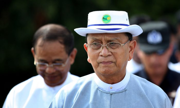 Burma's President Thein Sein walks on the historic U Bein bridge while assessing environmental changes at Taungthaman lake in Amarapura, Mandalay, Burma, on Sept. 27, 2015. Myanmar's president has assured the nation that his government and the military, which gave up power only five years ago, will respect the results of Sunday, Nov. 8, elections that are expected to be won by opposition leader Aung San Suu Kyi's party. (AP Photo/Hkun Lat)