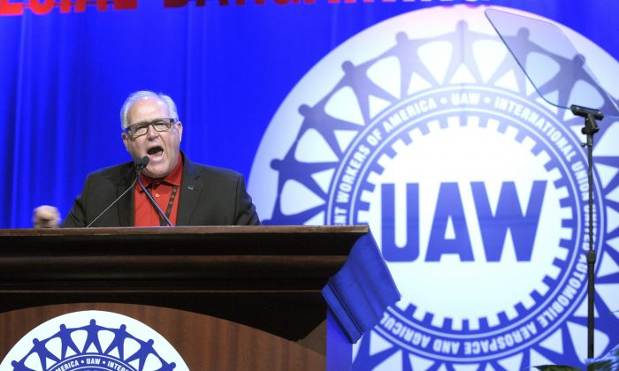 United Auto Workers President Dennis Williams addresses UAW members in Detroit on March 25, 2015. UAW members at General Motors appear poised to approve a new four-year contract with the company. Workers at two union locals at a huge factory in Lordstown, Ohio, east of Cleveland, and at an SUV assembly plant near Lansing, Michigan, voted overwhelmingly for the deal on Friday, Nov 6, 2015. (Todd McInturf/Detroit News via AP)