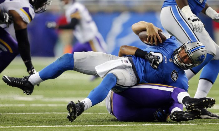 Detroit Lions quarterback Matthew Stafford (9) is sacked by Minnesota Vikings inside linebacker Eric Kendricks during the second half of an NFL football game, in Detroit, on Oct. 25, 2015. (AP Photo/Rick Osentoski)