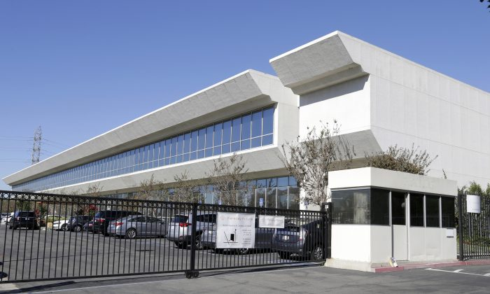 Faraday Future building in Gardena, Calif., on Nov. 6, 2015. Faraday Future has been hunting for a place to build what it says will be a $1 billion manufacturing plant for a new line of cars. Four states are contenders and the company says to expect an announcement within weeks. Like Tesla, Faraday's car will be all-electric, and debut at the high end. (AP Photo/Nick Ut)