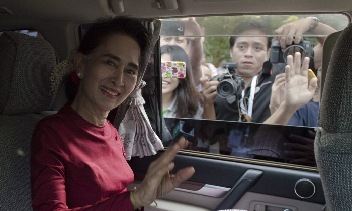 Burma opposition leader and head of the National League for Democracy (NLD) Aung San Suu Kyi leaves her house to cast her vote at a polling station in Yangon on Nov. 8, 2015. The historic poll could see Suu Kyi's opposition launched to power after decades of army rule. (Nicolas Asfouri/AFP/Getty Images)