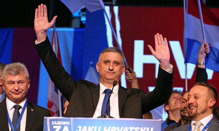 Leader of the conservative opposition Croatian Democratic Union party, Tomislav Karamarko (C), and supporters celebrate initial results of the general elections in Zagreb, on Nov. 8, 2015. Croatia's conservative opposition was leading the vote count late Nov. 8, 2015, after a general election dominated by concerns over the migrant crisis and a sluggish economy. (STR/AFP/Getty Images)