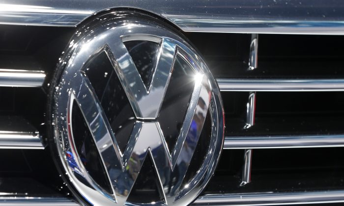 FILE - In this Sept. 22, 2015, file photo, the Volkswagen logo of a car is photographed during a car show in Frankfurt, Germany. A dealer familiar with Volkswagen's plans says the automaker intends to offer $1,000 in gift cards and vouchers to owners of smaller diesel cars as a gesture of goodwill to owners with 2-liter four-cylinder diesel engines that have been implicated in an emissions cheating scandal. (AP Photo/Michael Probst, File)