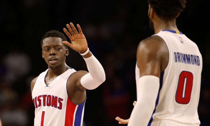 Reggie Jackson (L) and Andre Drummond are each averaging better than 20 points per game for the 5–1 Detroit Pistons. (Gregory Shamus/Getty Images)