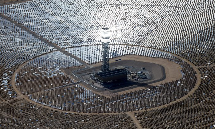 The Ivanpah Solar Electric Generating System in the Mojave Desert in California, near Primm, Nevada, on Feb. 20, 2014. The largest solar thermal power-tower system in the world, owned by NRG Energy, Google and BrightSource Energy, and formally opened in February 2014 in the Ivanpah Dry Lake, it uses 347,000 computer-controlled mirrors to focus sunlight onto boilers on top of three 459-foot towers, where water is heated to produce steam to power turbines providing power to more than 140,000 California homes. (Ethan Miller/Getty Images)