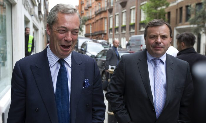 U.K. Independence Party (UKIP) leader Nigel Farage (L) and major donor Arron Banks leave the party's head office in central London on May 15, 2015. (Justin Tallis/AFP/Getty Images)