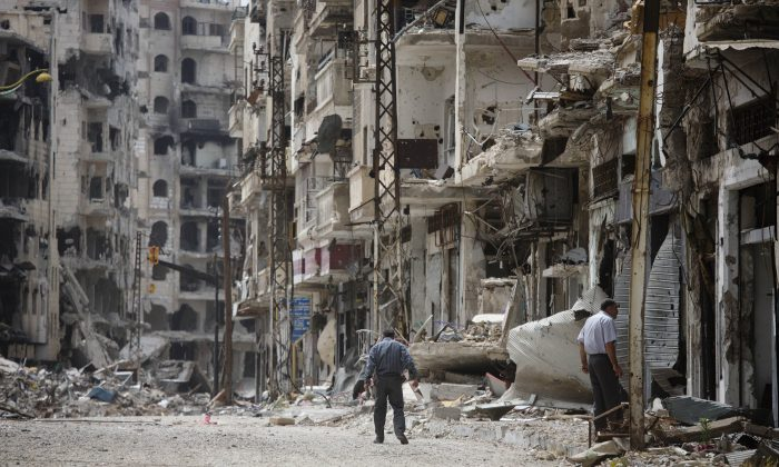 A man walks through a devastated part of Homs, Syria, on June 5, 2014. (AP Photo/Dusan Vranic)