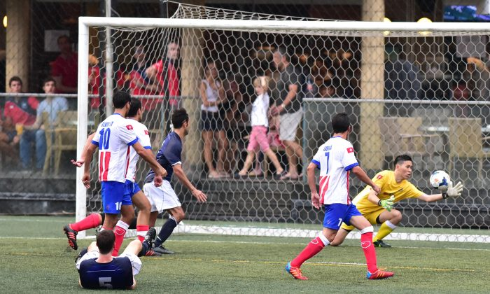 Stock photo of action in the Club Wanderers match vs The Store House Squadron on Oct 4, 2015. (Bill Cox/Epoch Times)