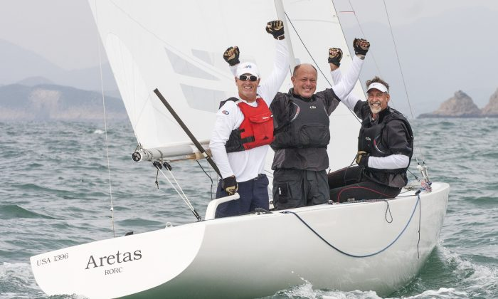 Skip Dieball and crew John McCl;ean and Jeff Eiber of 'Aretas' celebrate their win in the Etchells World Championships 2015 in Hong Kong on Saturday Nov 7, 2015. (2015 Etchells Worlds/Guy Nowell)