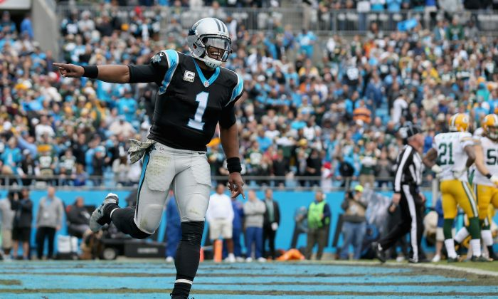 Cam Newton #1 of the Carolina Panthers celebrates a touchdown pass against the Green Bay Packers in the 2nd quarter during their game at Bank of America Stadium on November 8, 2015 in Charlotte, North Carolina. (Photo by Streeter Lecka/Getty Images)
