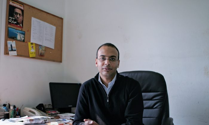 This Dec. 7, 2011 photo, shows Hossam Bahgat in his office at the Egyptian Initiative for Personal Rights in Garden City, Cairo, Egypt. (AP Sarah Rafea via AP) MANDATORY CREDIT