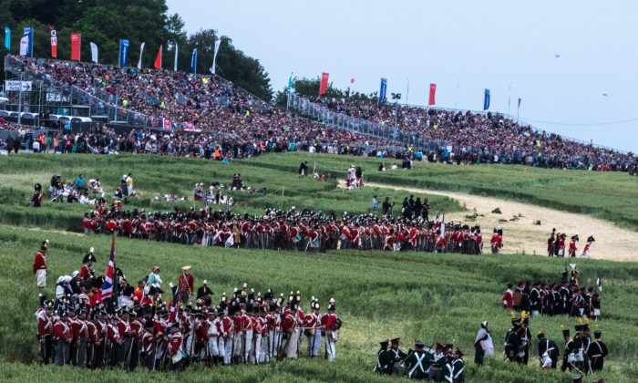A capacity crowd watches as soldiers gather for a re-enactment of the Battle of Waterloo, held annually in Waterloo, Belgium. This year's event marked the 200th anniversary of the battle, and was much bigger than other years, with more than 6,200 re-enactors participating. (Mohammed Reza Amirinia)