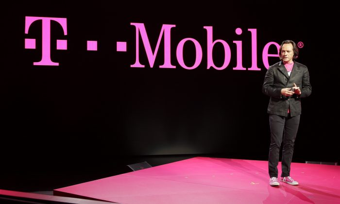 T-Mobile CEO John Legere speaks at T-Mobile's Uncarrier 5.0 event in Seattle on June 18, 2014. Streaming video from Netflix, HBO and other leading services will no longer count toward data limits under T-Mobile's higher data plans. (AP Photo/Ted S. Warren)