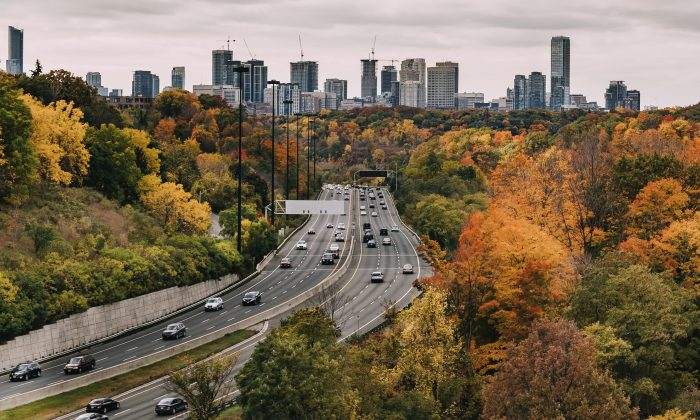 TORONTO, CANADA - 19TH OCTOBER 2014: Cars on the Don Valley Highway in Toronto during the Fall. The city can be seen in the distance.