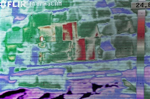 Live footage from a thermal camera of limestone blocks from the Khufu pyramid are displayed showing different colors representing varying temperatures during a press conference, in Giza, Egypt, Monday, Nov. 9, 2015. (AP Photo/Nariman El-Mofty)