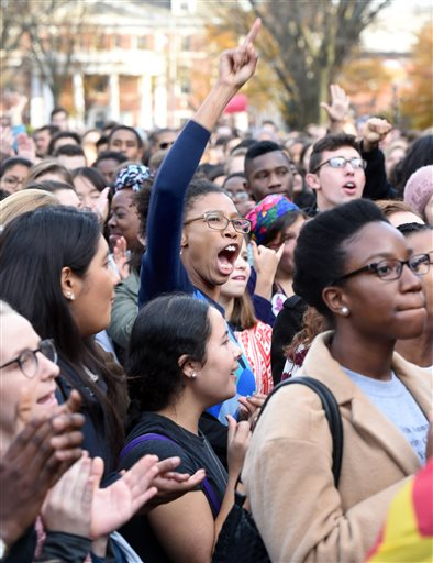 Yale University students and faculty rally to demand that Yale University become more inclusive to all students on Cross Campus in New Haven on Monday, Nov. 9, 2015. (Arnold Gold/New Haven Register via AP)