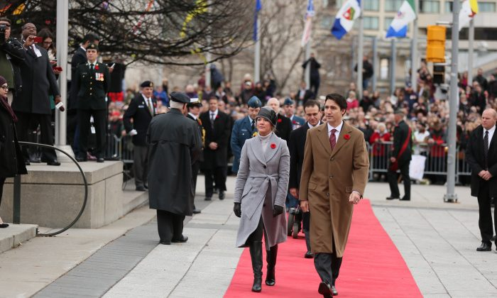 Prime Minister Justin Trudeau and his wife Sophie Gregoire-Trudeau attend the Remembrance Day ceremonies at the National War Memorial  Ottawa, on Wednesday November 11, 2015.  (Annie Wu/Epoch Times)