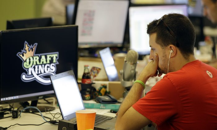 Customers of the two biggest daily fantasy sports websites, DraftKings and FanDuel have filed at least four lawsuits against the sites in October of 2015, following cheating allegations. (AP Photo/Stephan Savoia)