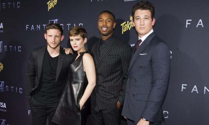 """FILE - In this Aug. 4, 2015 file photo, Jamie Bell, from left, Kate Mara, Michael B. Jordan and Miles Teller attend the premiere of """"Fantastic Four"""" at the Williamsburg Cinemas in the Brooklyn borough of New York. (Charles Sykes/Invision/AP, File)"""