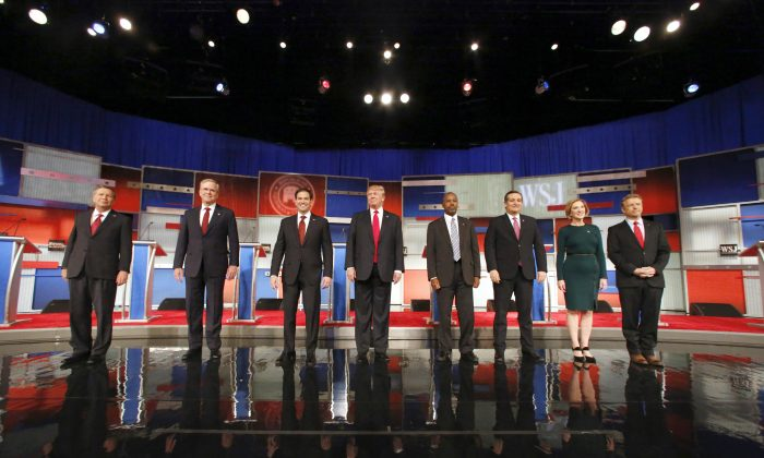 Republican presidential candidates (L-R) John Kasich, Jeb Bush, Marco Rubio, Donald Trump, Ben Carson, Ted Cruz, Carly Fiorina, and Rand Paul take the stage before the Republican presidential debate at the Milwaukee Theatre, Tuesday, Nov. 10, 2015, in Milwaukee. (AP Photo/Jeffrey Phelps)