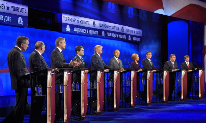 Republican presidential candidates (L-R) John Kasich, Mike Huckabee, Jeb Bush, Marco Rubio, Donald Trump, Ben Carson, Carly Fiorina, Ted Cruz, Chris Christie, and Rand Paul at the CNBC Republican presidential debate at the University of Colorado in Boulder, Colo., on Oct. 28, 2015. (AP Photo/Mark J. Terrill)
