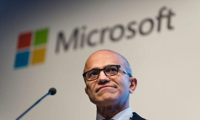 Microsoft's chief executive Satya Nadella speaks during a presentation in Berlin, Germany, Wednesday, Nov. 11, 2015. Microsoft said it will use data centers inside Germany to store German customers' data amid ongoing concerns over privacy. (Gregor Fischer/dpa via AP)