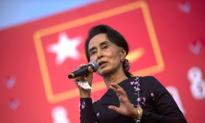 Aung San Suu Kyi speaks onstage during a campaign rally for the National League for Democracy in Yangon on Nov. 1, 2015. (Ye Aung Thu/AFP/Getty Images)
