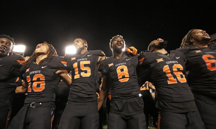 Oklahoma State routed TCU 49–29 yet haven't received much recognition from the CFP committee. (Brett Deering/Getty Images)