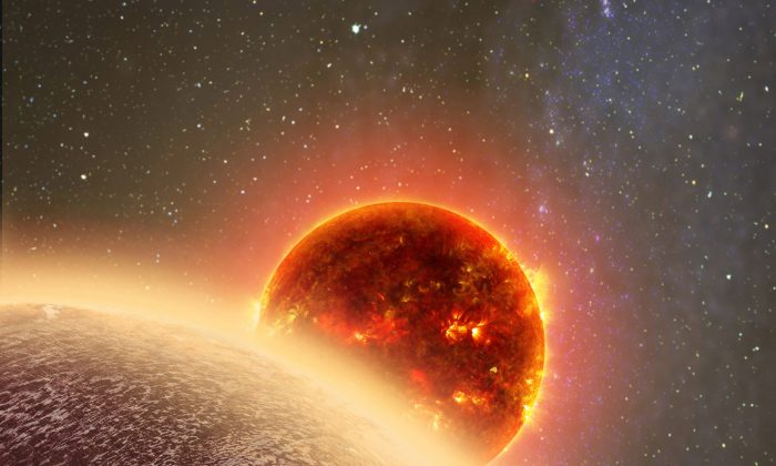 This artist's conception made by Dana Berry of SkyWorks and provided by NASA on Nov. 6, 2015 shows GJ 1132b, foreground, a rocky planet similar to the Earth in size and mass, orbiting a red dwarf star. (Dana Berry/SkyWorks/NASA via AP)