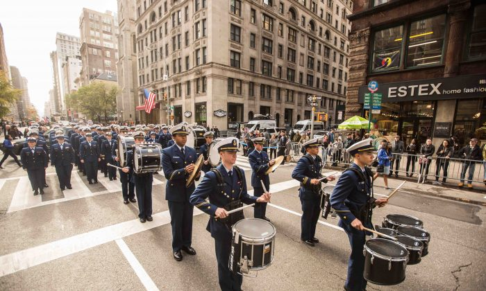Coast Guardsmen march during the Veterans Day parade in New York City on Nov. 11, 2015. (Benjamin Chasteen/Epoch Times)