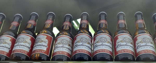 Bottles of Budweiser beer in a shop window in London on Oct. 13, 2015. Budweiser maker Anheuser-Busch InBev on Wednesday Nov. 11, 2015 announced a final agreement to buy SABMiller for 71 billion pounds ($107 billion), in a deal that will combine the world's two biggest brewers and create a company that makes almost a third of the beer consumed worldwide. (AP Photo/Kirsty Wigglesworth)