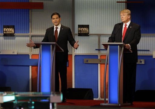 Marco Rubio, left, makes a point as Donald Trump listen during the Republican presidential debate at the Milwaukee Theatre, Tuesday, Nov. 10, 2015, in Milwaukee. (AP Photo/Jeffrey Phelps)