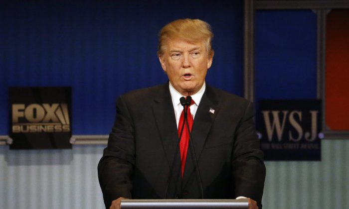 Donald Trump speaks during a Republican presidential debate at Milwaukee Theatre, Tuesday, Nov. 10, 2015, in Milwaukee. (AP Photo/Morry Gash)