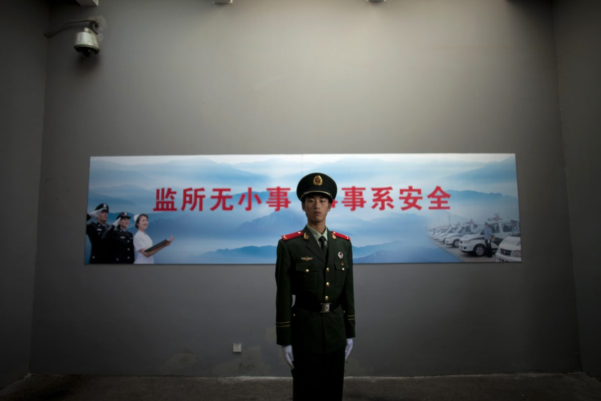 A Chinese paramilitary policeman stands guard at an entrance to the Number Two Detention Center in Beijing, China, on Oct. 25, 2012. A report by Amnesty International on Nov. 12, 2015 details the Chinese regime's practice of using torture to extract confessions from detainees. (AP Photo/Alexander F. Yuan)